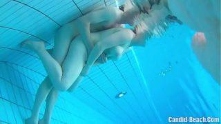 sexe sous l'eau pour ce couple de nudistes libertin